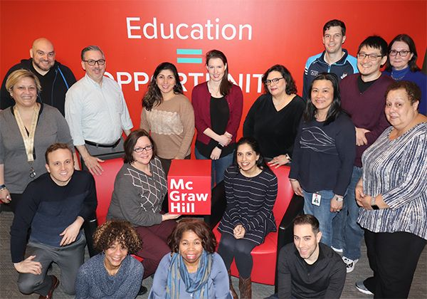 McGraw-Hill Employees holding the red cube logo