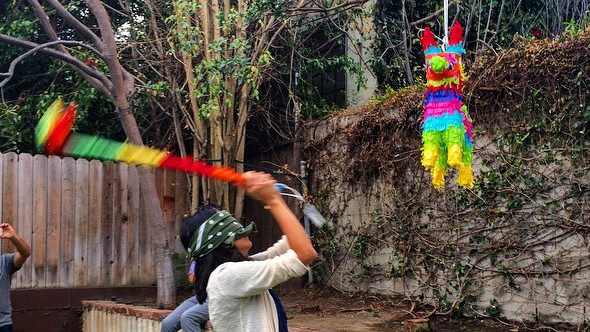 Female hitting a pinata