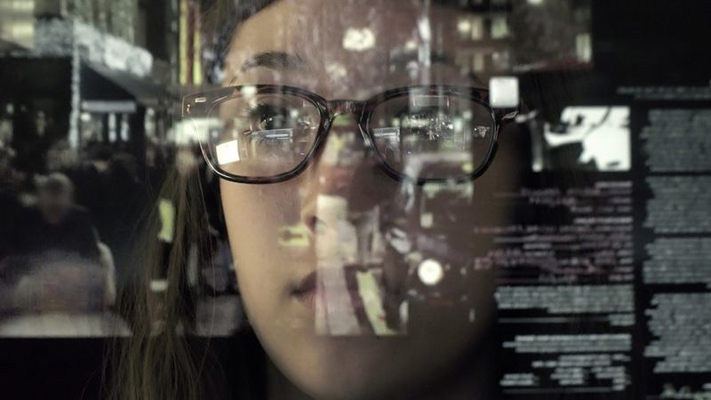 Face surrounded by data